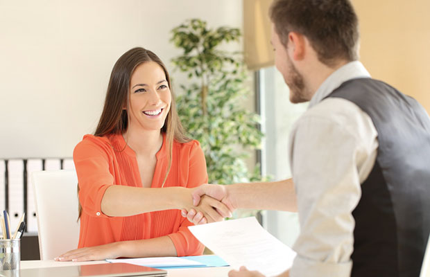 Photo shows young woman in a job interview